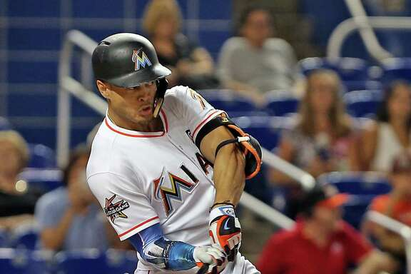 Giancarlo Stanton, who hit 59 home runs with the Marlins in 2017, would give the Yankees two reigning league champs. Aaron Judge led the AL with 52.