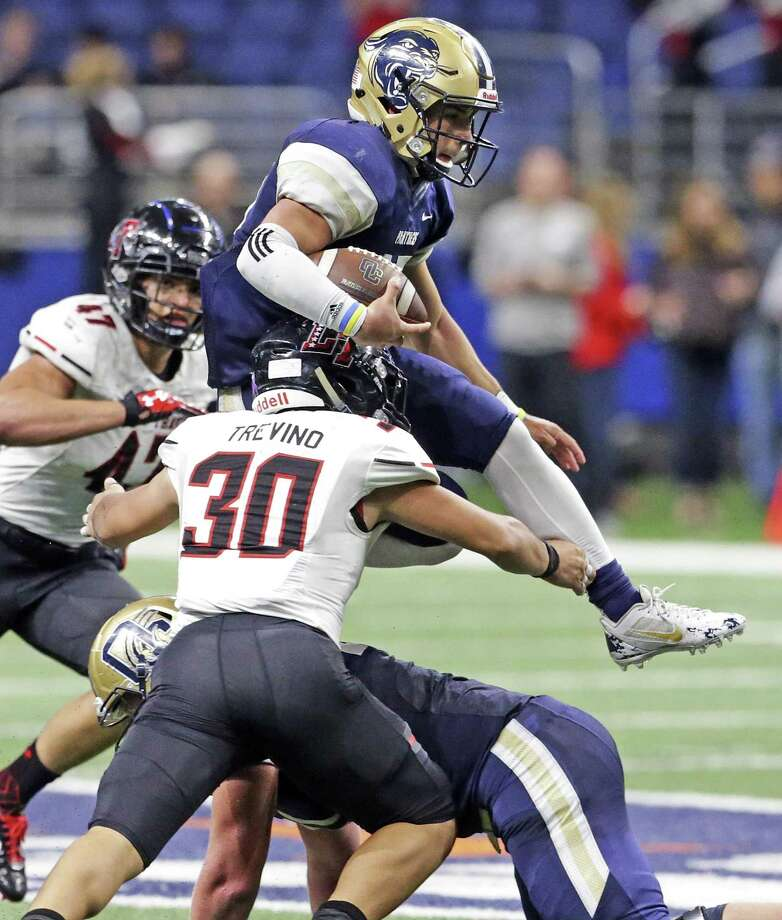 Panther quarterback Roel Sanchez goes high to get away from Cav tackler Mauricio Trevino as O'Connor plays Lake Travis in the Class 6A Division I state quarterfinals at the Alamodome December 9, 2017 Photo: Tom Reel, Staff / San Antonio Express-News / 2017 SAN ANTONIO EXPRESS-NEWS