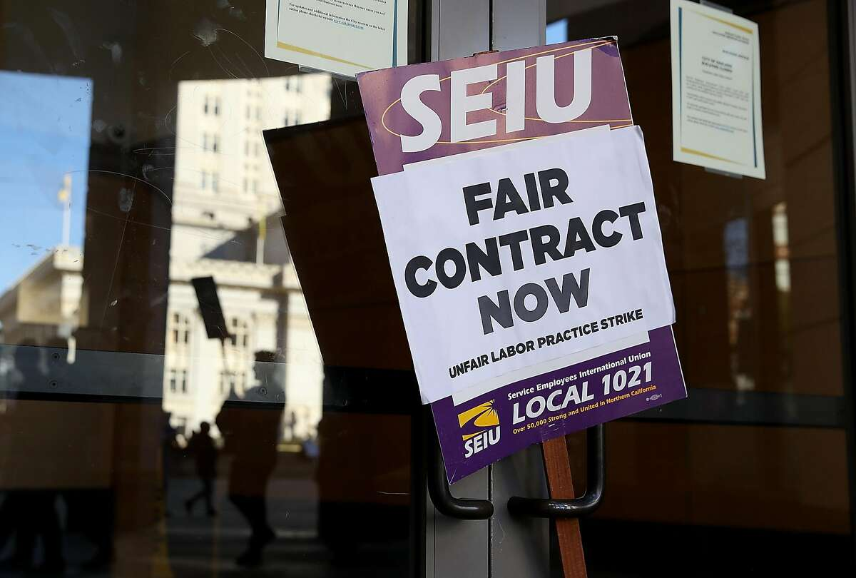 OAKLAND, CA - DECEMBER 05: A sign sits in front of a door to a City of Oakland building on December 5, 2017 in Oakland, California. Thousands of Oakland city workers went on strike early Tuesday as contract negotiations stalled out following the expiration of the unions� contract in July. (Photo by Justin Sullivan/Getty Images)