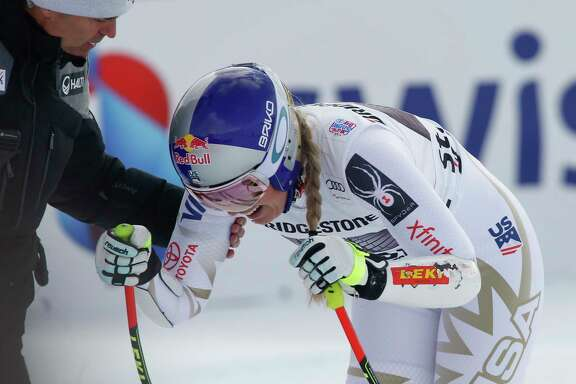 American Lindsey Vonn grimaces in pain after finishing her World Cup super-G race at St. Moritz, Switzerland. She is being treated for a back injury.