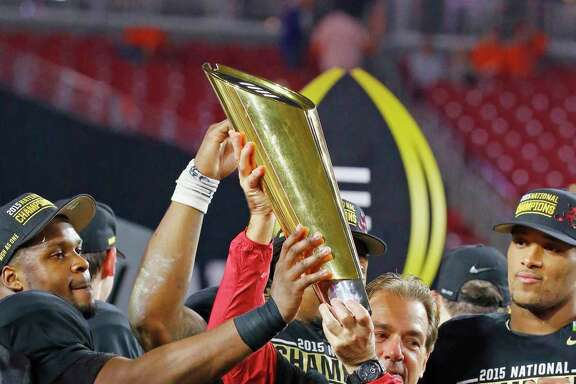 Alabama head coach Nick Saban and players celebrate after the NCAA college football playoff championship game against Clemson, Monday, Jan. 11, 2016, in Glendale, Ariz. Alabama won 45-40. (David Kadlubowski/The Arizona Republic via AP) MARICOPA COUNTY OUT; MAGS OUT; NO SALES; MANDATORY CREDIT