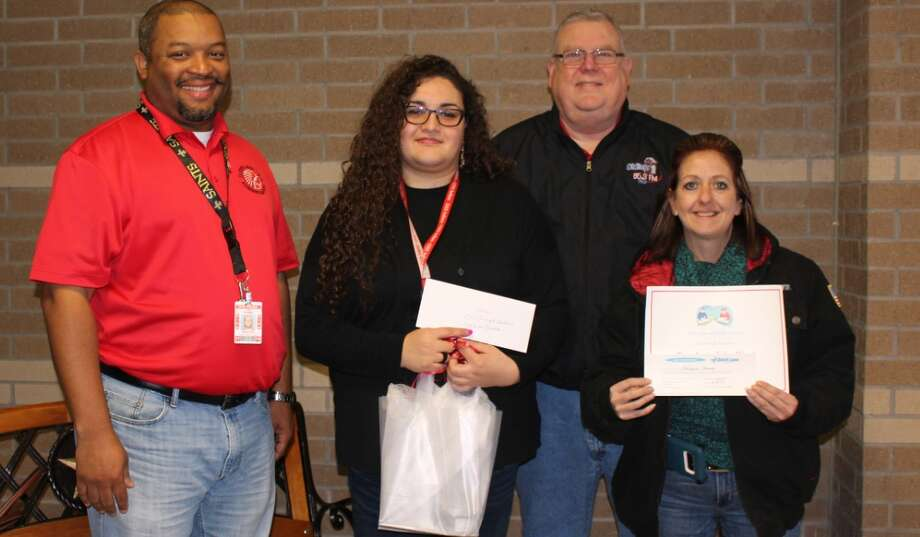 Ashleigh Canales is the Cleveland ISD Teacher of the Week for the week ending Dec. 8, 2017. She teaches geometry at Cleveland High School. Canales received her bachelor's degree in mathematics with a minor in marketing at Southern Utah University. Pictured with Canales (second from left) is CHS Principal Dr. Glenn Barnes, Jeff McClain with KORG and Peggy Land with Quick Lane Tire and Auto. The award is sponsored each week by KORG, Anderson Ford Quick Lane Tire and Auto, Easy Street Florist, El Burrito and Chef's House. Photo: Submitted