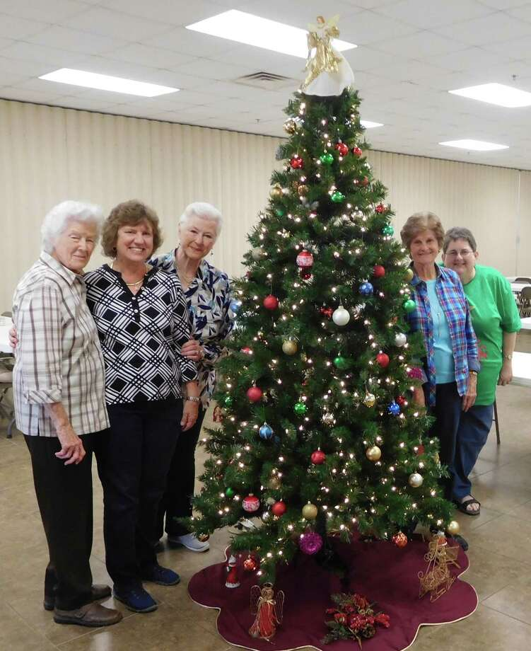 Members of the Woman's Club of Cleveland can think of no better way to honor the spirit of Christmas than by decorating the Christmas tree at the Cleveland Senior Citizens Center.  The entire club wishes everyone a Merry Christmas and Happy 2018!  Pictured doing the decorating are (left to right) CSCO Director Maxine Morris, members Claire Garrett, Sharon Carter, Claire Barker and Pat Barrington. Photo: Submitted