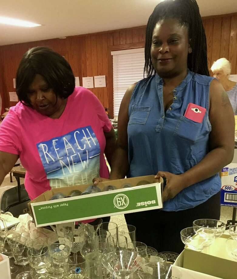 Juanita Washington and Mary Jackson shop at the CAPL garage sale. Photo: Submitted