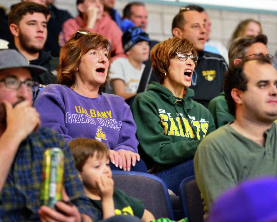 Sisters Michelle Wolsey, left, of Ballston Spa and Maria Guyette of Albany root for opposing teams during the Albany Cup game between UAlbany and Siena College Saturday Dec. 9, 2017 in Albany, NY.  (John Carl D'Annibale / Times Union) Photo: John Carl D'Annibale / 20041657A