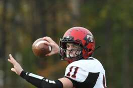Glens Falls quarterback Joseph Girard III winds up for a pass in the third quarter of the Class B Super Bowl against Schuylerville on Saturday in Clifton Park. Glens Falls beat Schuylerville 40-37 after making a field goal in overtime. (Jenn March/Special to the Times Union)