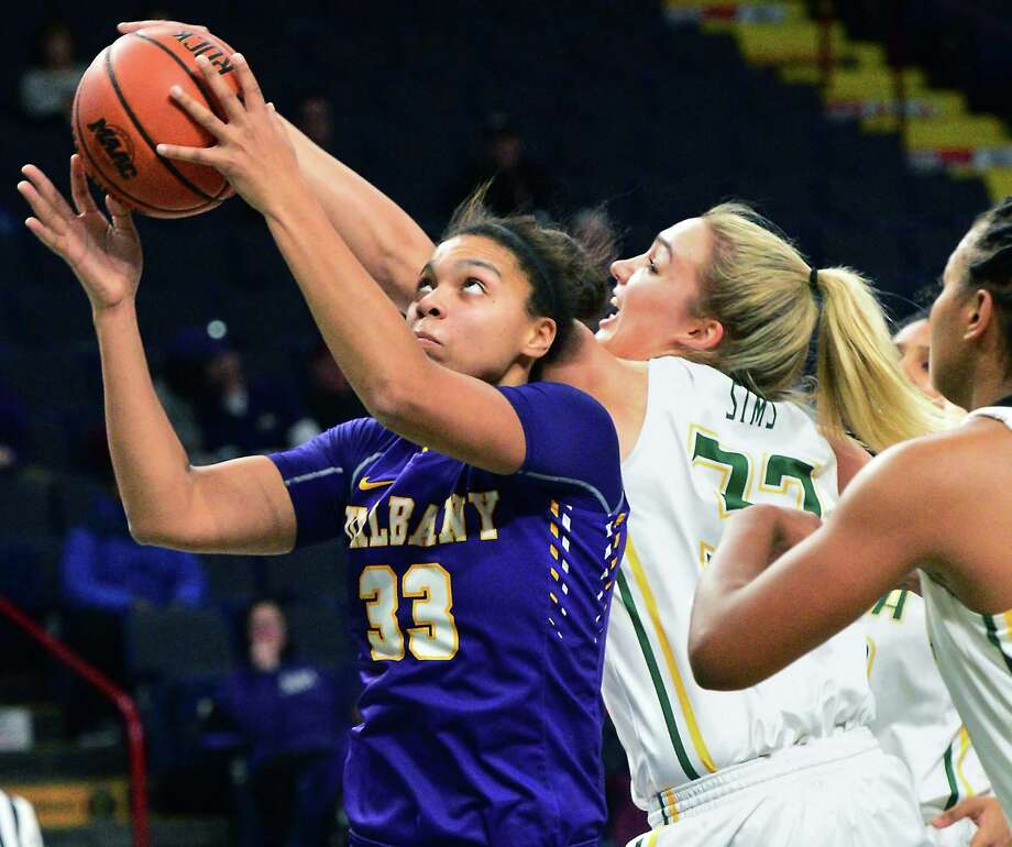 UAlbany's #33 Tiana-Jo Carter,left, battles Siena's #32 Maddie Sims during their Albany Cup game at the Times Union Center Saturday Dec. 9, 2017 in Albany, NY.  (John Carl D'Annibale / Times Union) Photo: John Carl D'Annibale / 20042332A