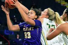 UAlbany's #33 Tiana-Jo Carter,left, battles Siena's #32 Maddie Sims during their Albany Cup game at the Times Union Center Saturday Dec. 9, 2017 in Albany, NY.  (John Carl D'Annibale / Times Union)