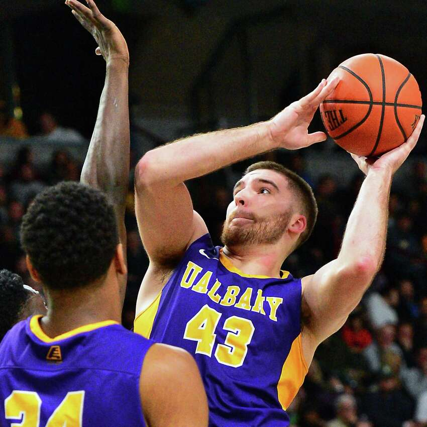 Albany's #43 Greg Stire rebounds during their Albany Cup game against Siena College at the Times Union Center Saturday Dec. 9, 2017 in Albany, NY. (John Carl D'Annibale / Times Union)