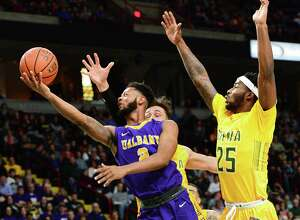 UAlbany's #2 Ahmad Clark gets past Siena defenders for two points during their Albany Cup game at the Times Union Center Saturday Dec. 9, 2017 in Albany, NY.  (John Carl D'Annibale / Times Union)