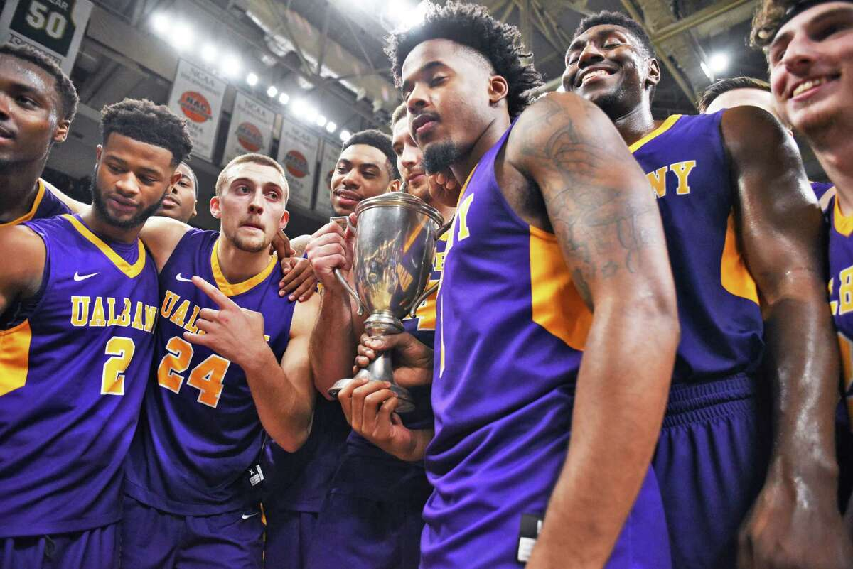 UAlbany celebrates with the Albany Cup after beating Siena at the Times Union Center Saturday Dec. 9, 2017 in Albany, NY. (John Carl D'Annibale / Times Union)