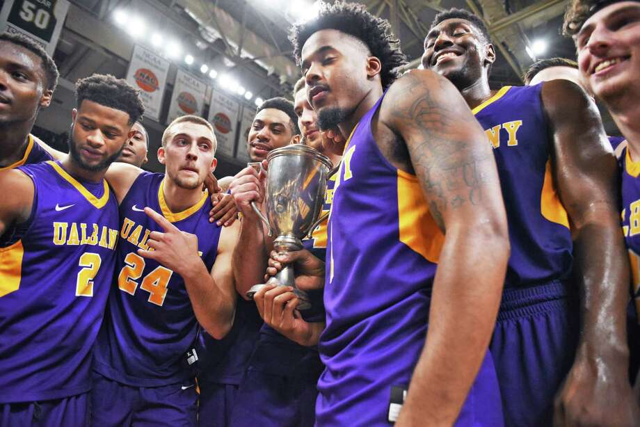 UAlbany celebrates with the Albany Cup after beating Siena at the Times Union Center Saturday Dec. 9, 2017 in Albany, NY.  (John Carl D'Annibale / Times Union) Photo: John Carl D'Annibale / 20041657A