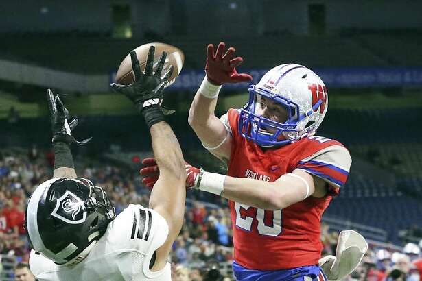 Chap's defender Collin Swallow deflects a pass in the end zone intended for Knight receiver Caden Sterns as Steele plays Westlake in the Class 6A Division II state quarterfinals at the Alamodome December 9, 2017