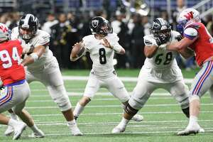 Knight quarterback Wyatt Begeal gets good protection as he looks for a target as Steele plays Westlake in the Class 6A Division II state quarterfinals at the Alamodome December 9, 2017