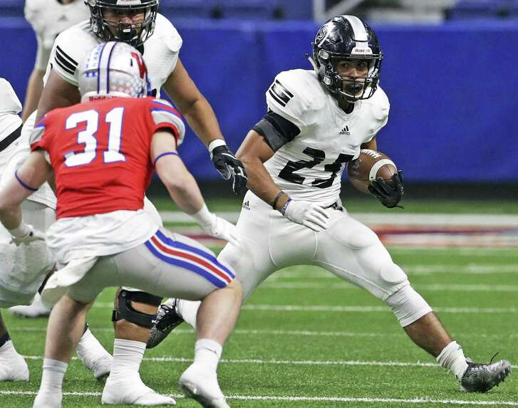 Brenden Brady rolls for the Knights as Steele plays Westlake in the Class 6A Division II state quarterfinals at the Alamodome December 9, 2017
