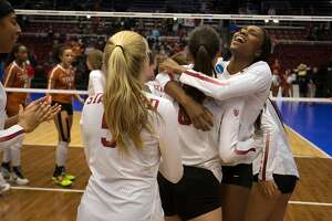 Stanford's Tami Alade, right, exults after her team defeated Texas in an NCAA women's volleyball regional match on Saturday, Dec. 9, 2017 in Stanford, Calif.. Stanford won in straight sets.