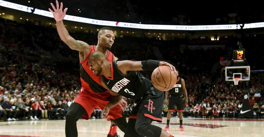 Houston Rockets guard Chris Paul drives to the basket as Portland Trail Blazers guard Damian Lillard defends during the first half of an NBA basketball game in Portland, Ore., Saturday, Dec. 9, 2017. (AP Photo/Steve Dykes) Photo: Steve Dykes/Associated Press