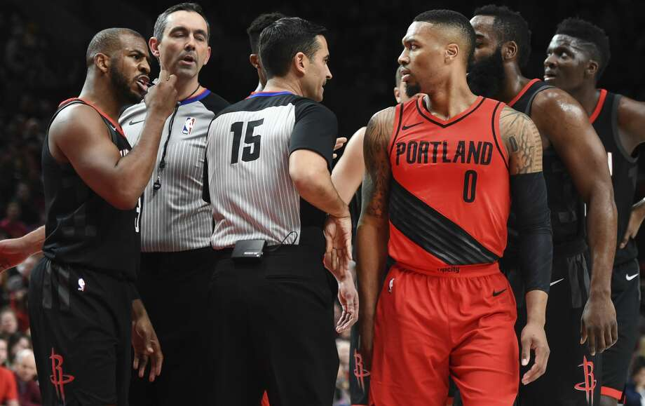 Houston Rockets guard Chris Paul, left, exchanges words with Portland Trail Blazers guard Damian Lillard after being called for a foul when he knocked Lillard down during the first half of an NBA basketball game in Portland, Ore., Saturday, Dec. 9, 2017. (AP Photo/Steve Dykes) Photo: Steve Dykes/Associated Press