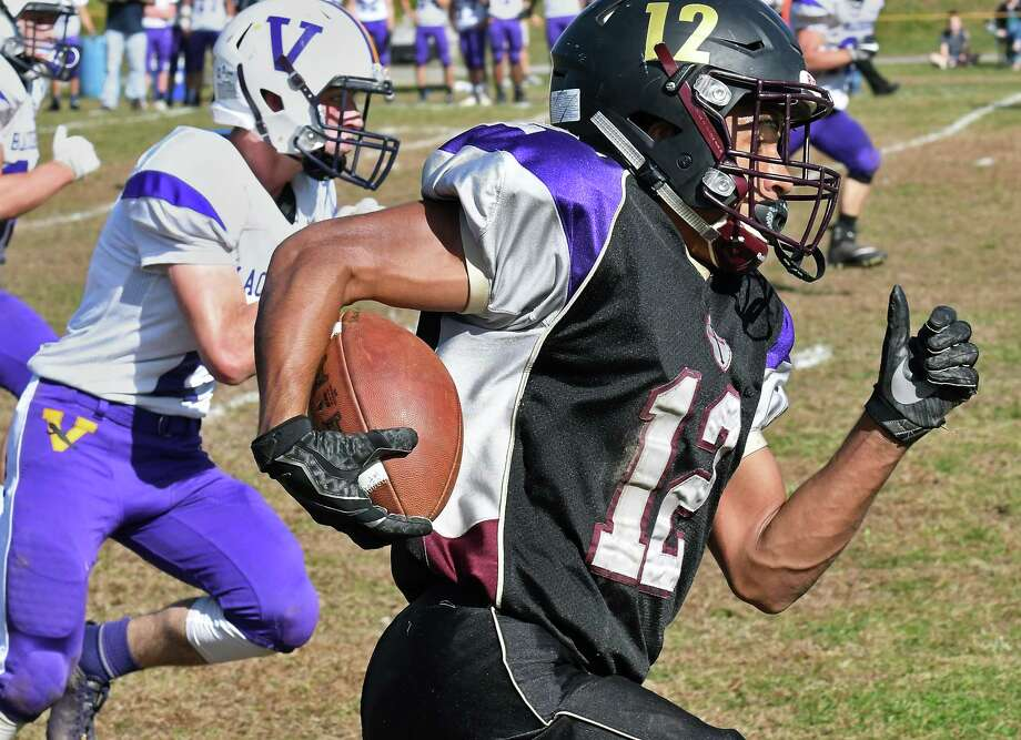 Holy Trinity's #12 Nacier Hundley out runs Voorheesvillle defenders during Saturday's game Oct. 21, 2017 in Schenectady, NY.  (John Carl D'Annibale / Times Union) Photo: John Carl D'Annibale / 20041877A