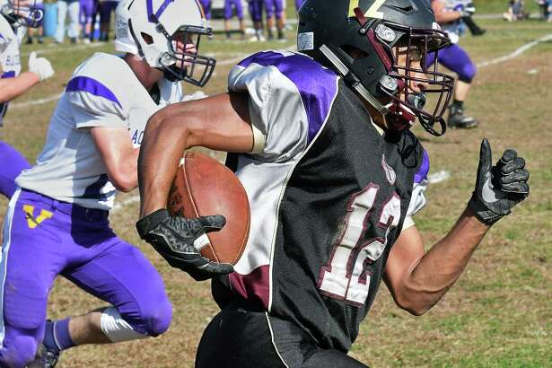 Holy Trinity's #12 Nacier Hundley out runs Voorheesvillle defenders during Saturday's game Oct. 21, 2017 in Schenectady, NY.  (John Carl D'Annibale / Times Union)
