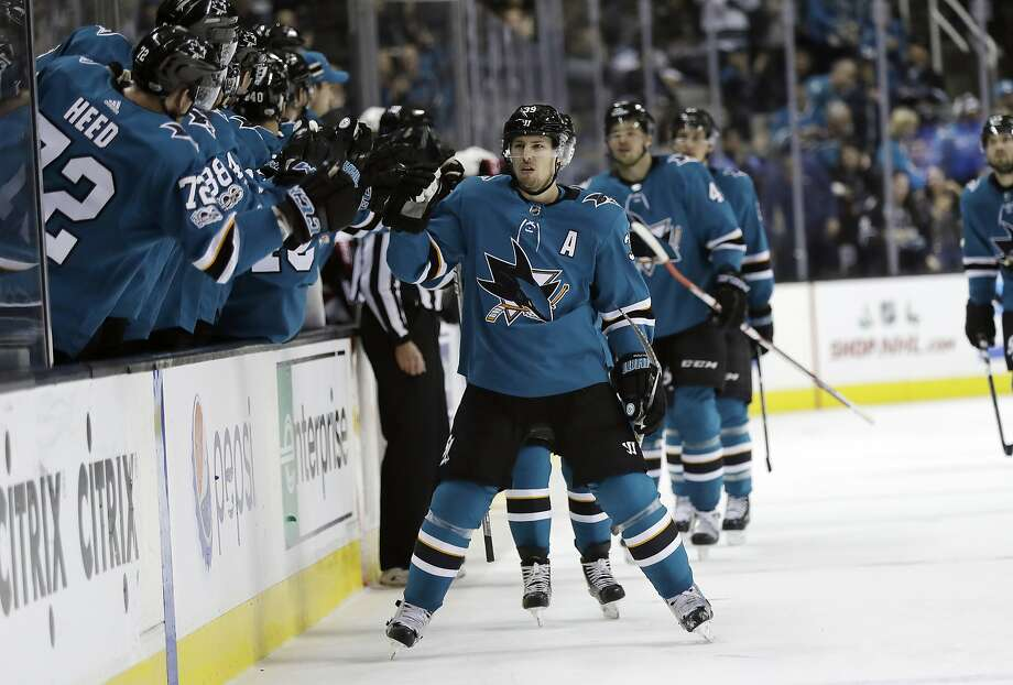 Logan Couture skates in front of the Sharks' bench to celebrate with teammates after scoring in the first period of San Jose's 5-0 win over the Senators at SAP Center. Photo: Marcio Jose Sanchez, Associated Press