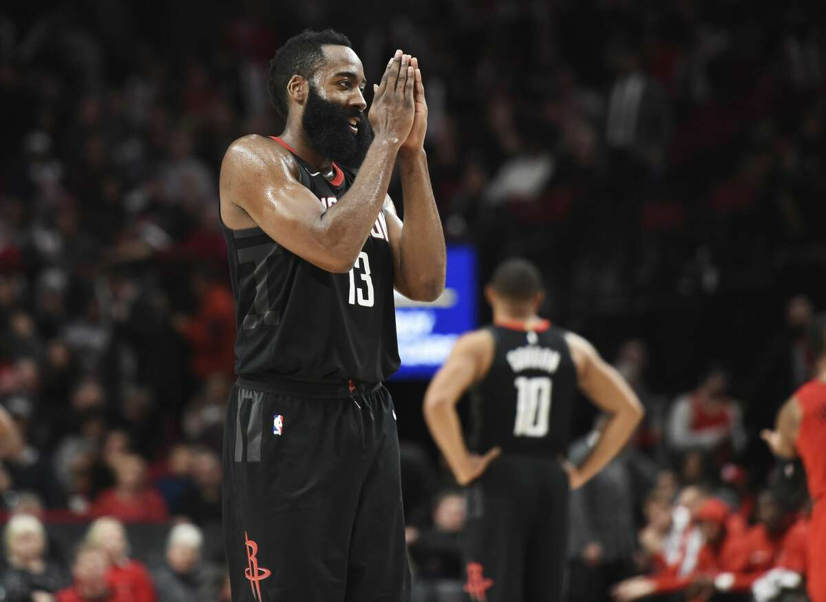 Houston Rockets guard James Harden reacts after scoring during the second half of the team's NBA basketball game against the Portland Trail Blazers in Portland, Ore., Saturday, Dec. 9, 2017. Harden scored 48 points as the Rockets won 124-117. (AP Photo/Steve Dykes)
