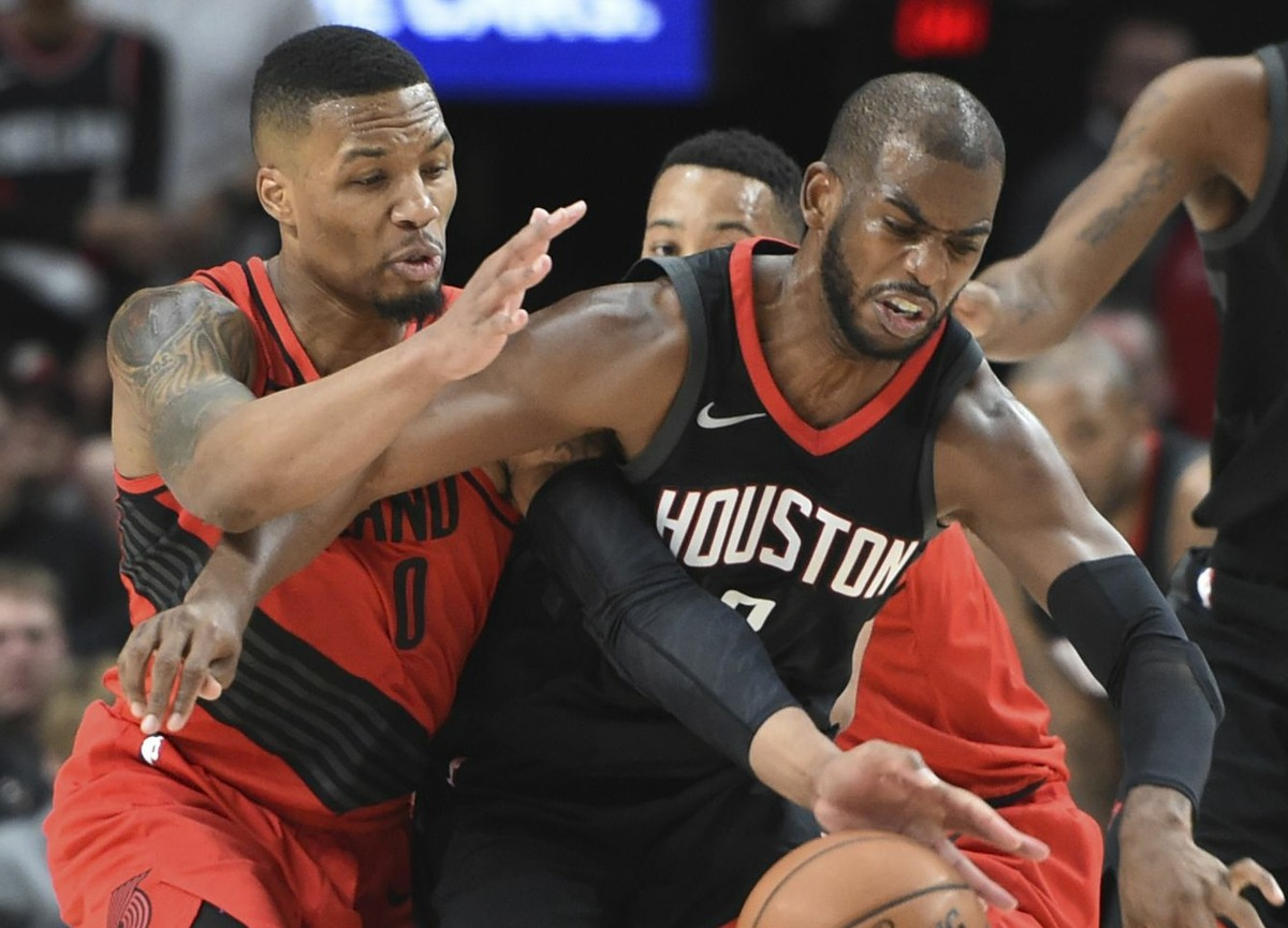 Portland Trail Blazers guard Damian Lillard, left, steals the ball from Houston Rockets guard Chris Paul during the second half of an NBA basketball game in Portland, Ore., Saturday, Dec. 9, 2017. The Rockets won 124-117. (AP Photo/Steve Dykes)