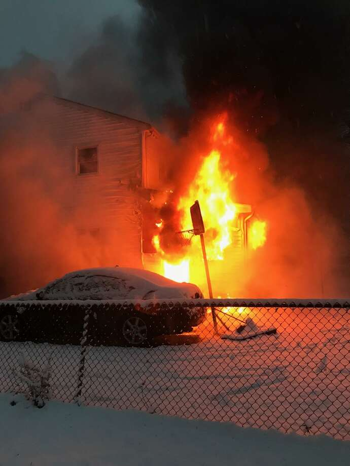 An early evening fire damaged a home at 260 Larkin Court during a snow storm. Photo: Contributed Photo