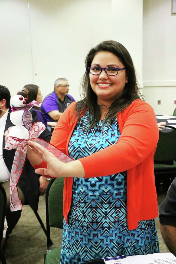 Sheila Martin holds up her winning entry in the Decorate a Snowman contest during the luncheon. Photo: David Taylor