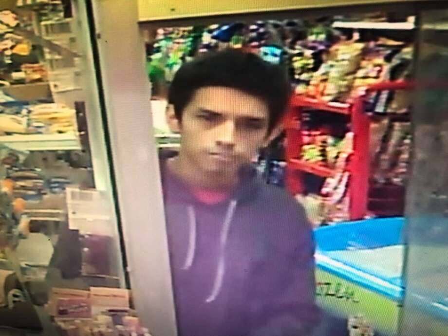 "Police are looking for a person of interest identified only as ""Juan"" after an overnight slaying. Photo: HPD, Metro Video"