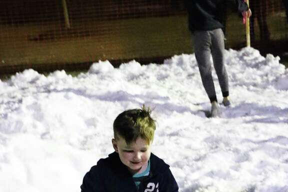 Finding snowballs and returning them to friends was the joy of playing in the snow at the Spirit of Christmas festival in Dayton Saturday night. Unexpectedly, Liberty County received a light snowfall late Thursday night and early Friday morning. Spirit of Christmas is sponsored by the City of Dayton and hosted by the Dayton Chamber of Commerce.