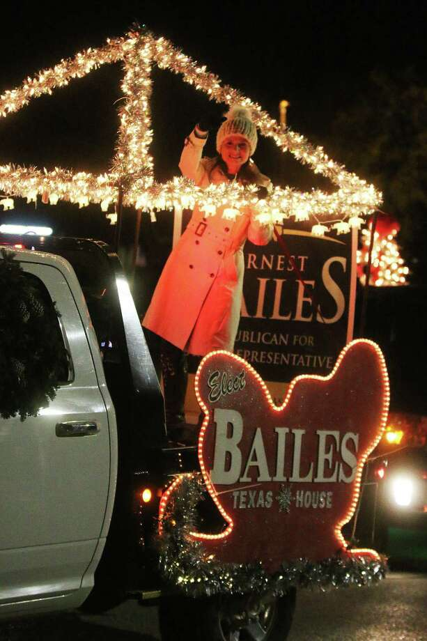 Courtney Bailes, wife of State Rep. Ernest Bailes, waves to the crowd during the Spirit of Christmas parade in Dayton Saturday. The parade is sponsored by the City of Dayton and hosted by the Dayton Chamber of Commerce. Photo: David Taylor