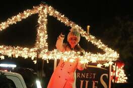 Courtney Bailes, wife of State Rep. Ernest Bailes, waves to the crowd during the Spirit of Christmas parade in Dayton Saturday. The parade is sponsored by the City of Dayton and hosted by the Dayton Chamber of Commerce.