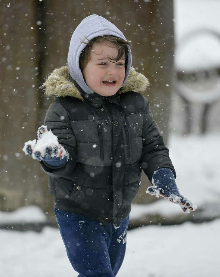 Endi Lekaj, 3, plays in the snow at Latham Park in Stamford, Conn. on Dec. 9, 2017. Photo: Matthew Brown / Hearst Connecticut Media / Stamford Advocate