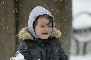 Endi Lekaj, 3, plays in the snow at Latham Park in Stamford, Conn. on Dec. 9, 2017.
