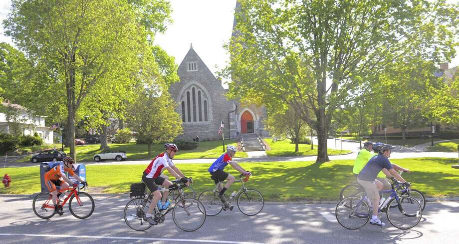 Cyclist ride down Main Street on their way to Town Hall during the second annual Bike to Work event Friday, May 19, 2017, in New Milford, Conn. Photo: H John Voorhees III / Hearst Connecticut Media / The News-Times