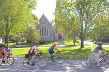 Cyclist ride down Main Street on their way to Town Hall during the second annual Bike to Work event Friday, May 19, 2017, in New Milford, Conn.