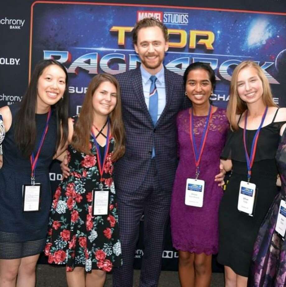 A group of STEM challenge finalists posed with the actor Tom Hiddleston on the red carpet before watching the premiere of Thor: Ragnarok. Photo: Stephanie Walsh / Contributed Photo / Stamford Advocate Contributed