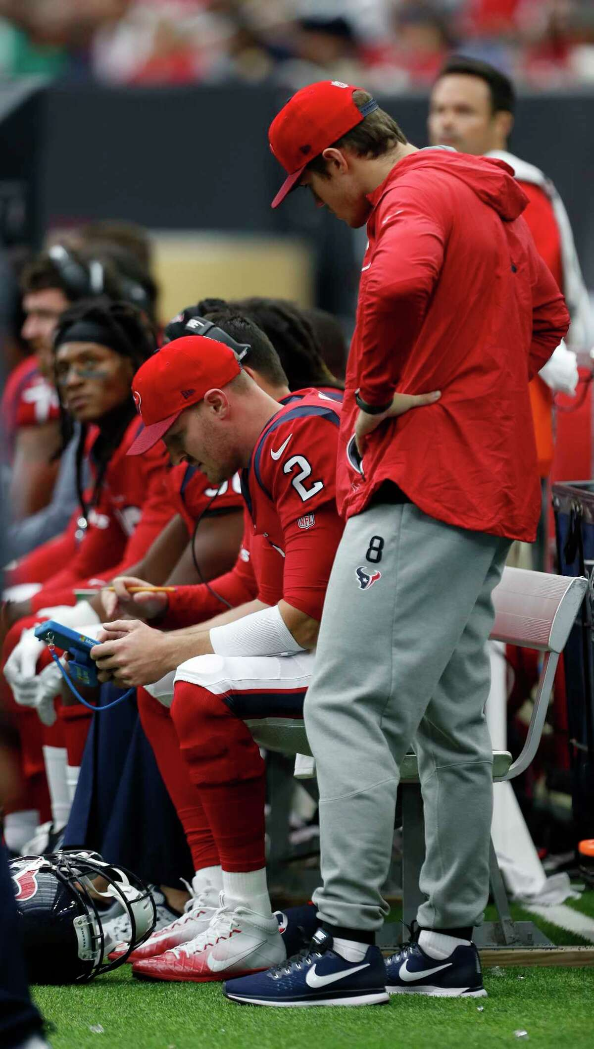 Houston Texans quarterback T.J. Yates (2) studies a play on the bench after taking over for Tom Savage during the second quarter of an NFL football game at NRG Stadium, Sunday, Dec. 10, 2017, in Houston.