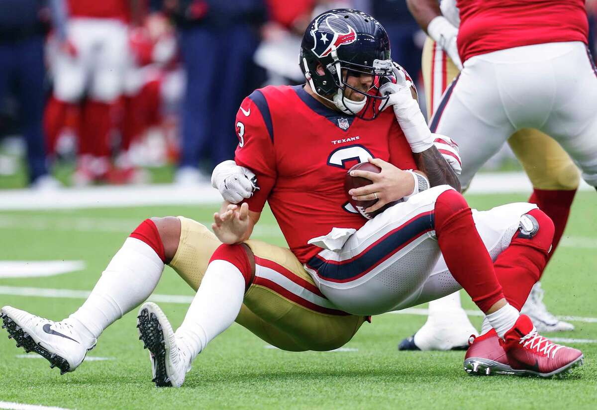 Houston Texans quarterback Tom Savage (3) is sacked by San Francisco 49ers outside linebacker Eli Harold (57) during the second quarter of an NFL football game at NRG Stadium on Sunday, Dec. 10, 2017, in Houston.