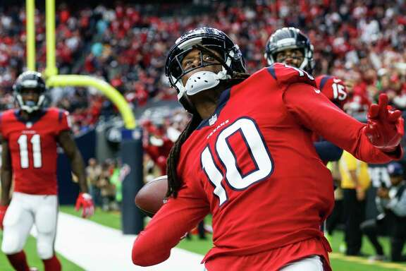 Houston Texans wide receiver DeAndre Hopkins (10) throws the football into the crowd after scoring on a 7-yard touchdown reception from quarterback T.J. Yates against the San Francisco 49ers during the second quarter of an NFL football game at NRG Stadium on Sunday, Dec. 10, 2017, in Houston.