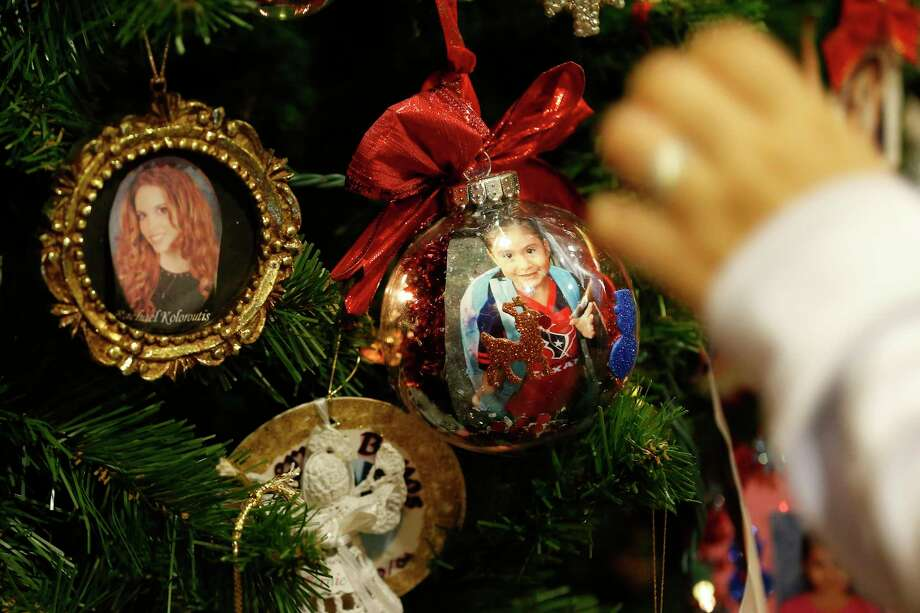 memorial ornaments are decorated in honor of a family members who had been a victim of