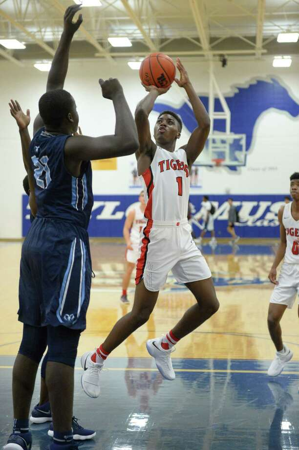 Ja'Koby Kennedy (1) of Katy takes a jump shot during pool play in the Phillips 66 Katy Classic between the Katy Tigers and the Elsik Rams on Thursday November 30, 2017 at Taylor HS, Katy, TX. Photo: Craig Moseley, Staff / ©2017 Houston Chronicle