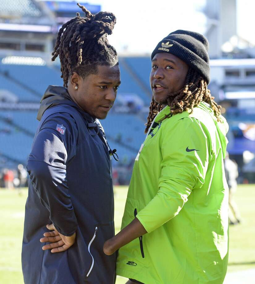Seattle Seahawks cornerback Shaquill Griffin, left, talks with his brother, Central Florida linebacker Shaquem Griffen, on the sideline before an NFL football game against the Jacksonville Jaguars, Sunday, Dec. 10, 2017, in Jacksonville, Fla. (AP Photo/Phelan M. Ebenhack) Photo: Phelan M. Ebenhack/AP