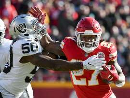 Kansas City Chiefs running back Kareem Hunt (27) is tackled by Oakland Raiders linebacker Nicholas Morrow (50) during the first half of an NFL football game against the Oakland Raiders in Kansas City, Mo., Sunday, Dec. 10, 2017. (AP Photo/Ed Zurga)
