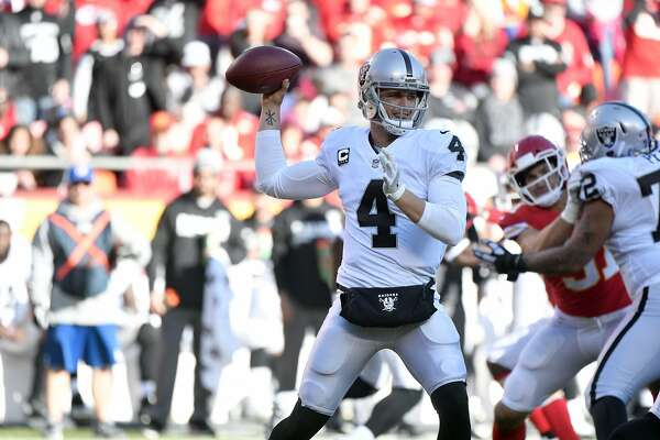 Oakland Raiders quarterback Derek Carr (4) throws as offensive tackle Donald Penn (72) blocks Kansas City Chiefs linebacker Frank Zombo (51) during the second half of an NFL football game in Kansas City, Mo., Sunday, Dec. 10, 2017. (AP Photo/Ed Zurga)