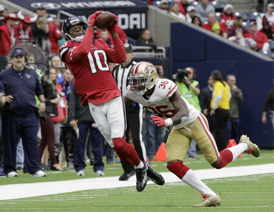 Houston Texans wide receiver DeAndre Hopkins (10) catches a pass over San Francisco 49ers cornerback Dontae Johnson (36) during the second half of an NFL football game Sunday, Dec. 10, 2017, in Houston. (AP Photo/Michael Wyke) Photo: Michael Wyke, Associated Press