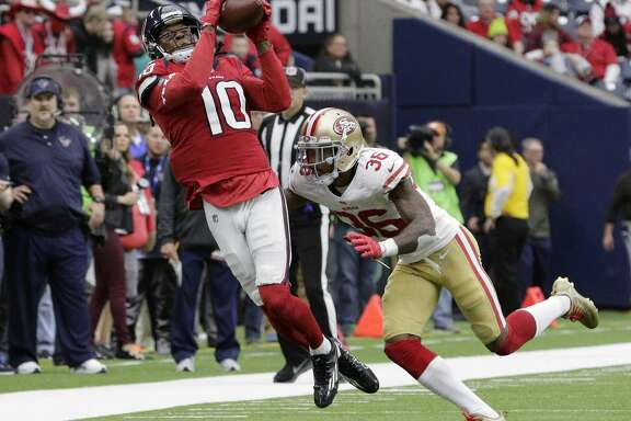 Houston Texans wide receiver DeAndre Hopkins (10) catches a pass over San Francisco 49ers cornerback Dontae Johnson (36) during the second half of an NFL football game Sunday, Dec. 10, 2017, in Houston. (AP Photo/Michael Wyke)