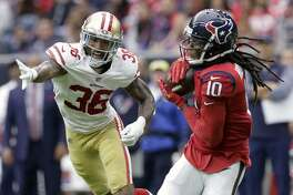 Houston Texans wide receiver DeAndre Hopkins (10) makes a catch in front of San Francisco 49ers cornerback Dontae Johnson (36) during the first half of an NFL football game, Sunday, Dec. 10, 2017, in Houston. (AP Photo/Michael Wyke)