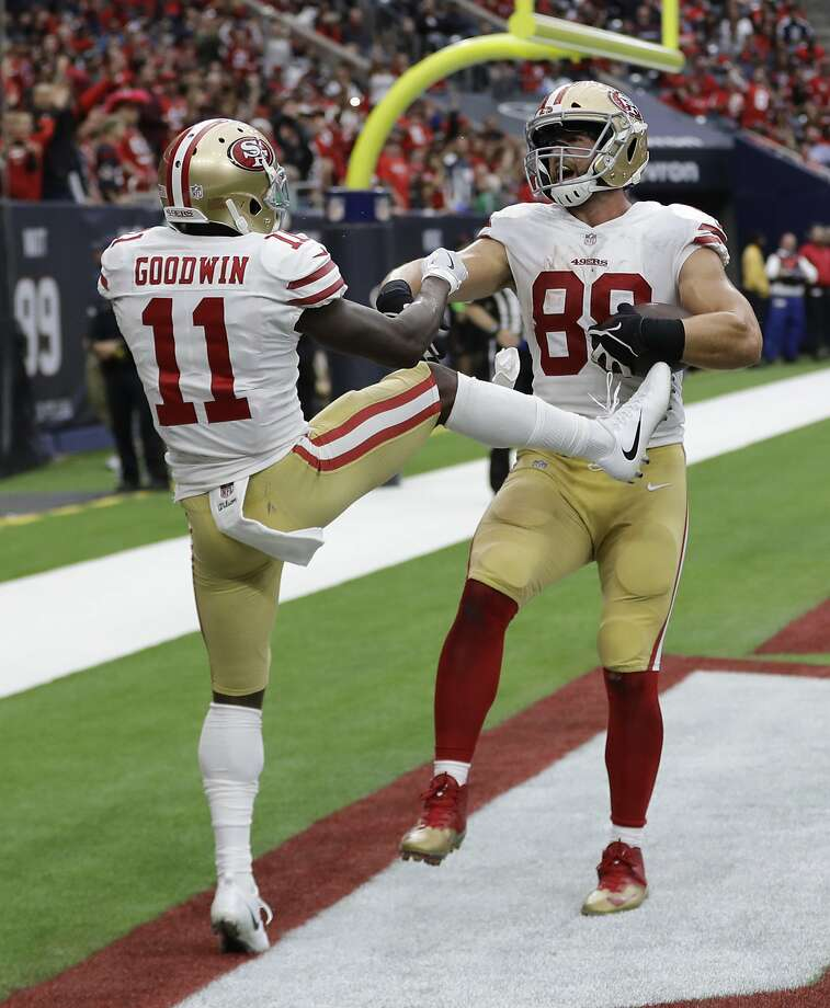 San Francisco 49ers tight end Garrett Celek (88) celebrates his touchdown catch with teammate Marquise Goodwin (11) during the second half of an NFL football game against the Houston Texans, Sunday, Dec. 10, 2017, in Houston. (AP Photo/David J. Phillip) Photo: David J. Phillip, Associated Press